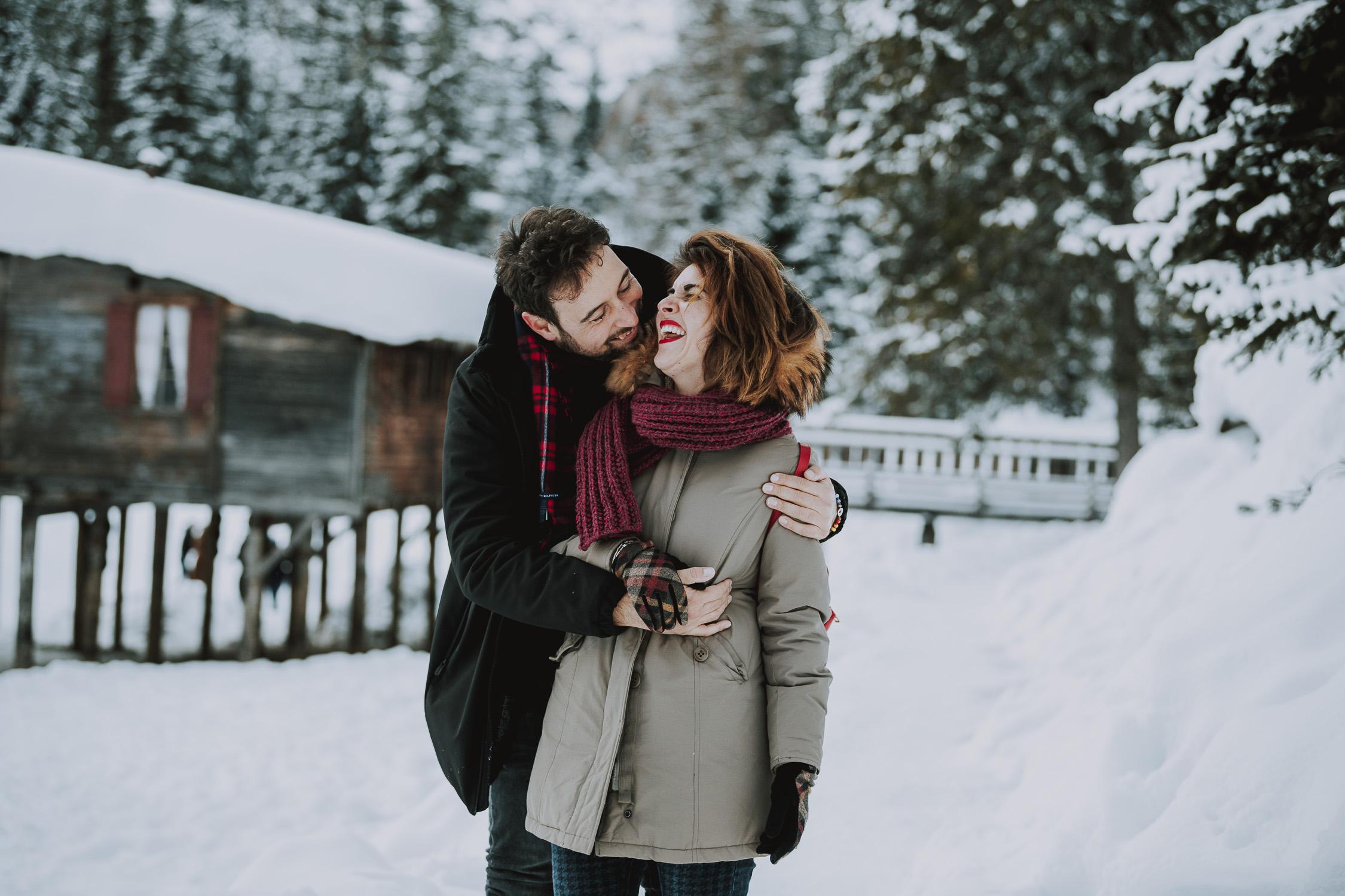 Couple at Lago di Braies in winter - Dolomites